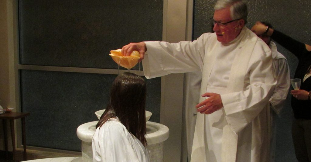 RCIA candidates are welcomed into the catholic church in baptism